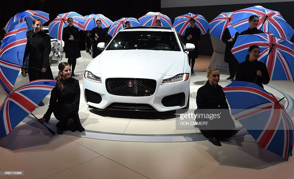 Dancing girls pose at the unveiling of the Jaguar media conference April 1 2015 during the New York Auto Show at the Jacob Javits Center in New York...