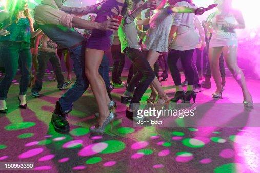 Dancing in a nightclub : Stock Photo