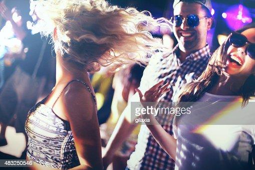 Dancing in a nightclub.
