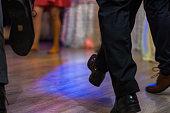 Dancing people feet on floor