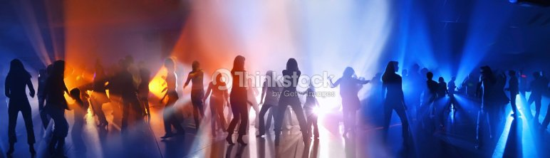 Dancing people in a disco : Stock Photo