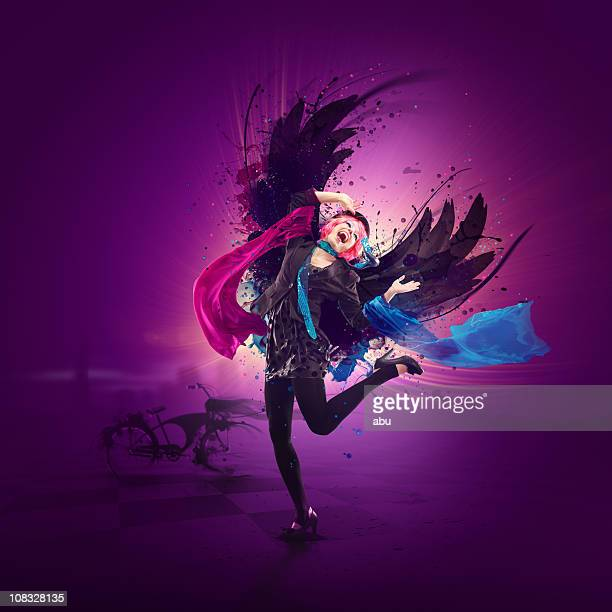Dancing queen with wings and colorful design around her