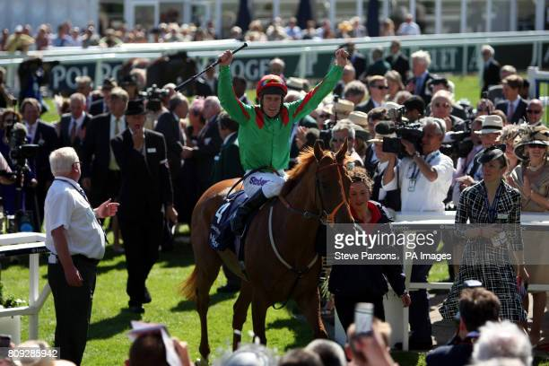 Dancing Rain ridden by Johnny Murtagh celebrates winning the Investec Oaks during Ladies Day at the Investec Derby Festival Epsom Downs Racecourse