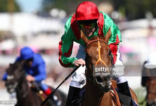 Dancing Rain ridden by Johnny Murtagh comes home to win The Investec Oaks