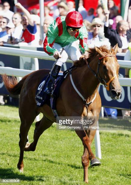 Dancing Rain ridden by Johnny Murtagh goes on to win the Investec Oaks during Ladies Day at the Investec Derby Festival Epsom Downs Racecourse