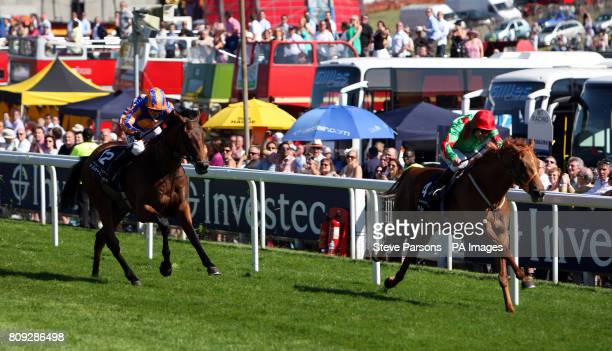 Dancing Rain ridden by Johnny Murtagh wins the Investec Oaks during Ladies Day at the Investec Derby Festival Epsom Downs Racecourse
