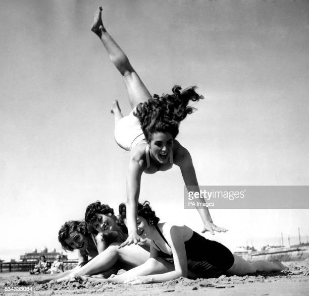 Dancing teacher Hazel Cleaver leaps over her friends as they enjoy the summer sunshine on the beach