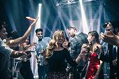 Shot of a young woman dancing in the nightclub