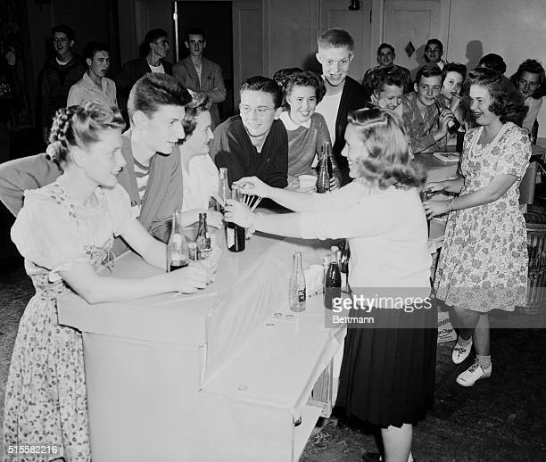 Dancing to the jive of some guest orchestra is hard at work so between numbers the young patrons gather at the glamorized soda fountain to rest and...