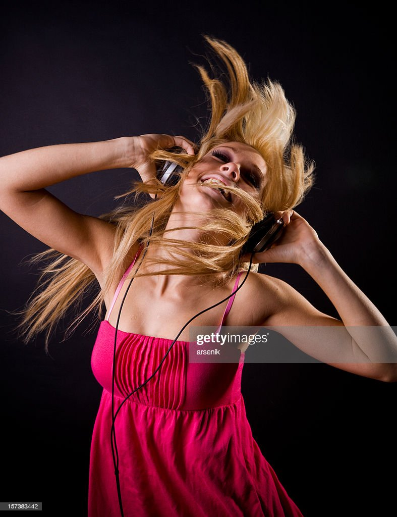 Dancing with headphones on : Stock Photo