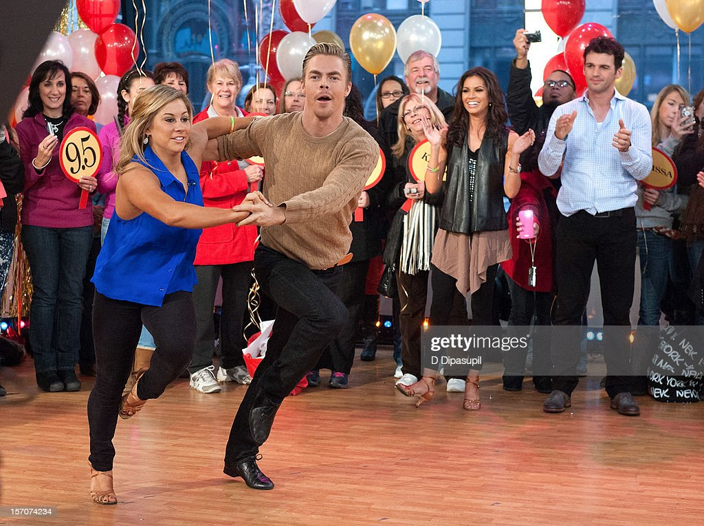 'Dancing With The Stars: All Stars' winners <a gi-track='captionPersonalityLinkClicked' href=/galleries/search?phrase=Melissa+Rycroft&family=editorial&specificpeople=5761590 ng-click='$event.stopPropagation()'>Melissa Rycroft</a> (4th R) and <a gi-track='captionPersonalityLinkClicked' href=/galleries/search?phrase=Tony+Dovolani&family=editorial&specificpeople=4395523 ng-click='$event.stopPropagation()'>Tony Dovolani</a> (2nd R) look on as finalists <a gi-track='captionPersonalityLinkClicked' href=/galleries/search?phrase=Shawn+Johnson+-+Gymnast&family=editorial&specificpeople=2330927 ng-click='$event.stopPropagation()'>Shawn Johnson</a> and <a gi-track='captionPersonalityLinkClicked' href=/galleries/search?phrase=Derek+Hough&family=editorial&specificpeople=4532214 ng-click='$event.stopPropagation()'>Derek Hough</a> perform on ABC's Good Morning America at ABC News' Good Morning America Times Square Studio on November 28, 2012 in New York City.