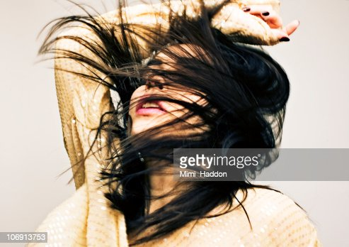 Dancing Woman with Hair in Face : Stock Photo