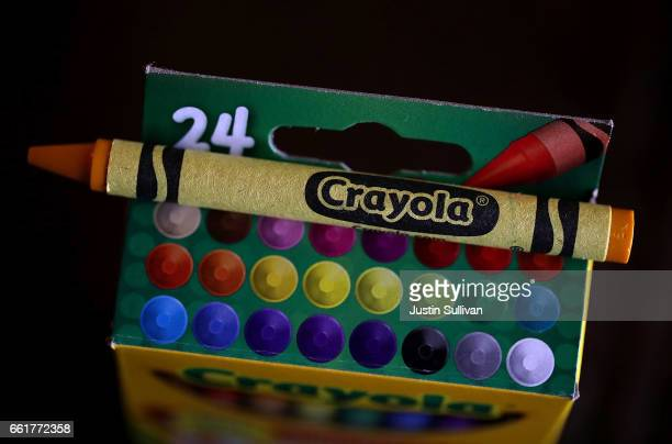 A dandelion yellow Crayola crayon sits on top of a 24 pack of Crayola Crayons on March 31 2017 in San Anselmo California Crayola announced that they...