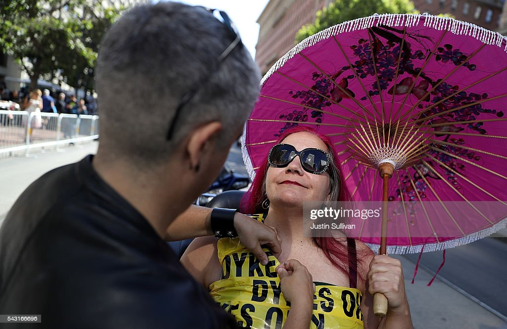 Dandy Buckley (L) helps Peggy Sue with her outfit before the start of the 2016 San Francisco Pride Parade on June 26, 2016 in San Francisco, California. Hundreds of thousands of people came out to watch the annual San Francisco Pride parade, one of the largest in the world.