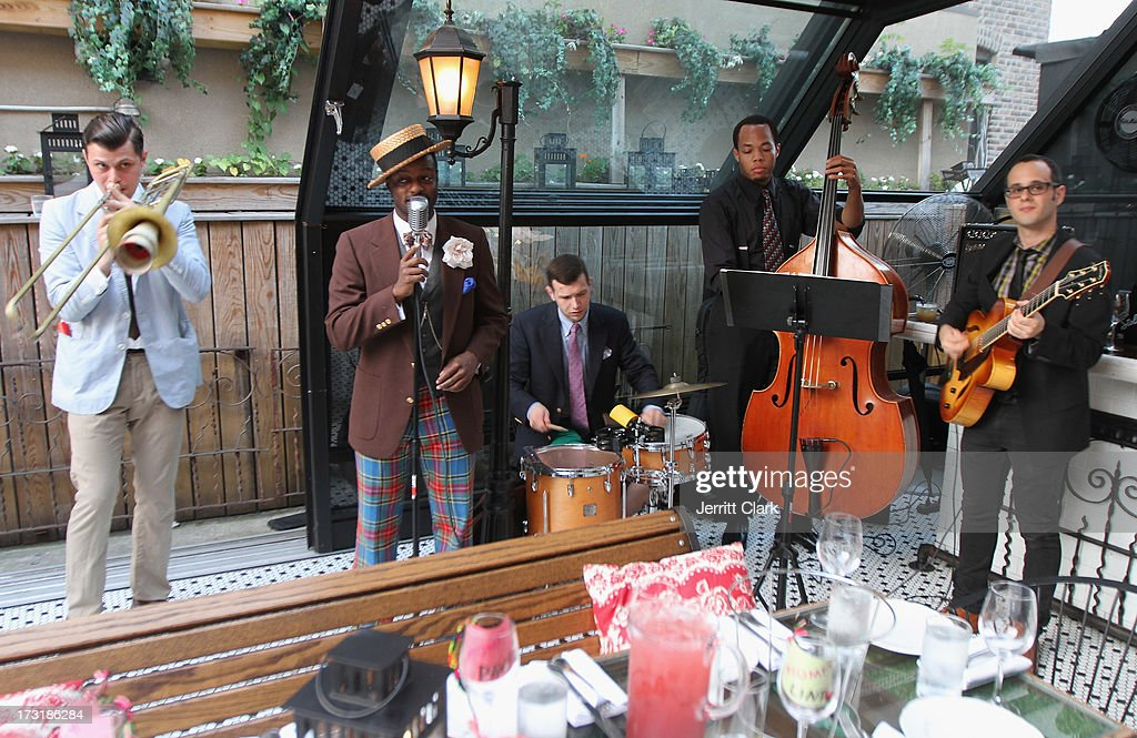 Dandy Wellington (2nd L) and his band perform at Sophia Bush's Birthday Party at Hotel Chantelle on July 8, 2013 in New York City.