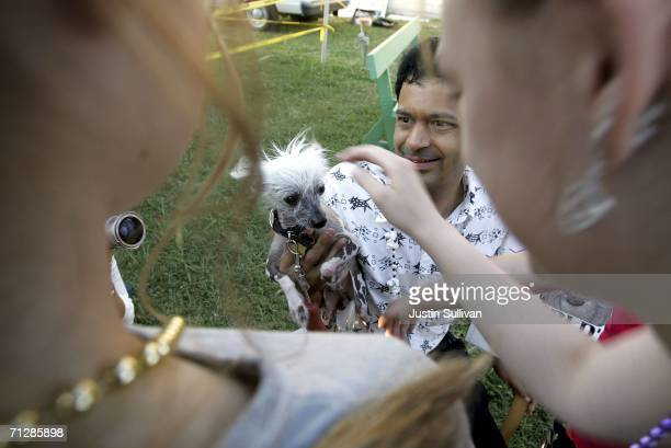 Dane Andrew shows off his dog Rascal the 2005 World's Ugliest Dog during the 18th annual World's Ugliest Dog competition June 23 2006 at the...