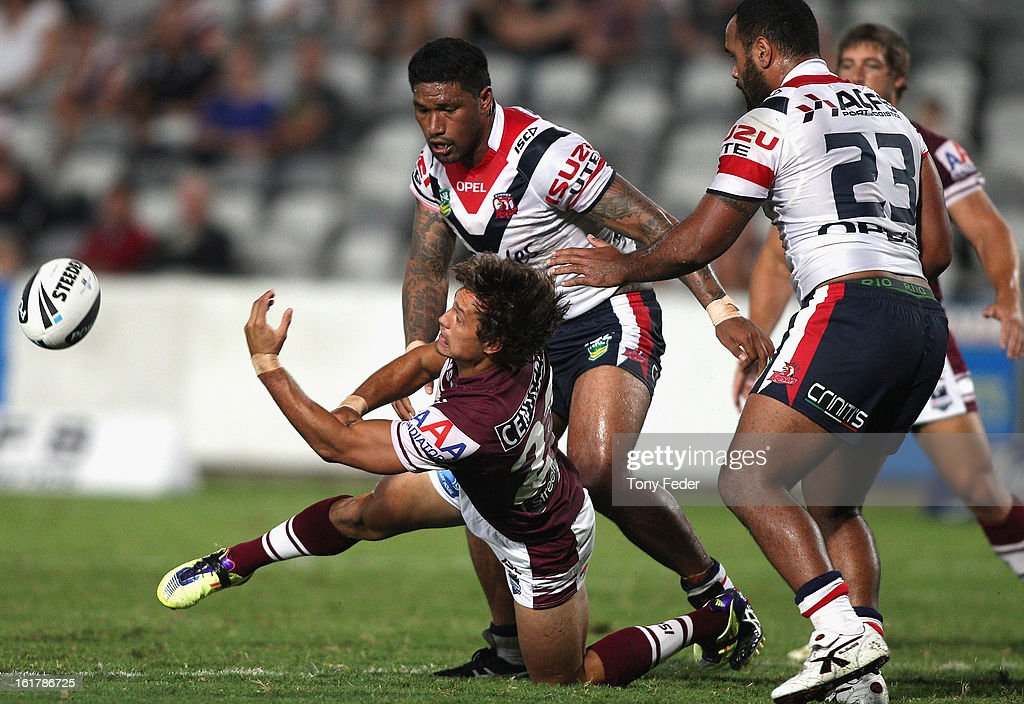 Dane Chisholm of the Sea Eagles tries to get his pass away during the NRL trial match between the Manly Sea Eagles and the Sydney Roosters at Bluetongue Stadium on February 16, 2013 in Gosford, Australia.