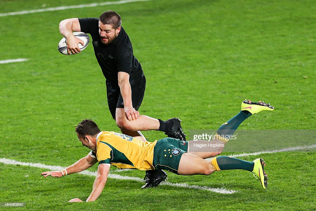 <a gi-track='captionPersonalityLinkClicked' href=/galleries/search?phrase=Dane+Coles&family=editorial&specificpeople=677007 ng-click='$event.stopPropagation()'>Dane Coles</a> of the All Blacks beats the tackle of <a gi-track='captionPersonalityLinkClicked' href=/galleries/search?phrase=Nic+White+-+Rugby+Player&family=editorial&specificpeople=10977486 ng-click='$event.stopPropagation()'>Nic White</a> of the Wallabies to score a try during The Rugby Championship, Bledisloe Cup match between the New Zealand All Blacks and the Australian Wallabies at Eden Park on August 15, 2015 in Auckland, New Zealand.