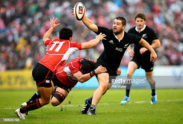 Dane Coles of the All Blacks offloads the ball during the International Rugby Test Match between Japan and the New Zealand All Blacks at Prince...