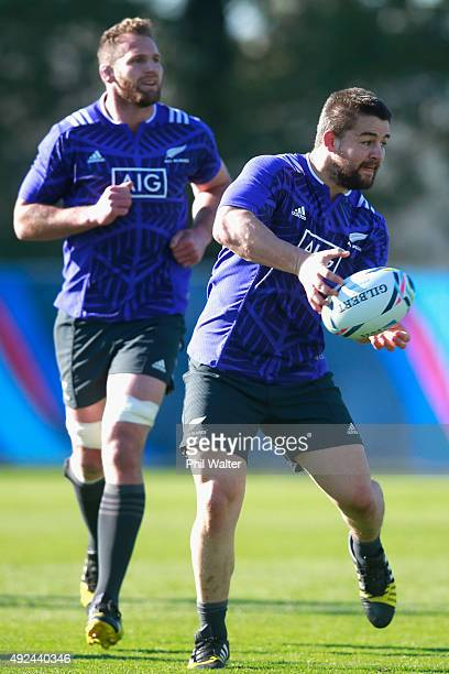 Dane Coles of the All Blacks passes during a New Zealand All Blacks training session at Swansea University on October 13 2015 in Swansea United...