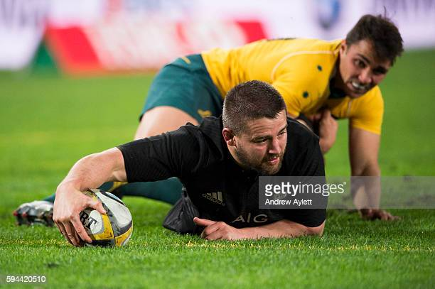 Dane Coles of the All Blacks scores a try during The Rugby Championship Bledisloe Cup match between the Australian Wallabies and the New Zealand All...