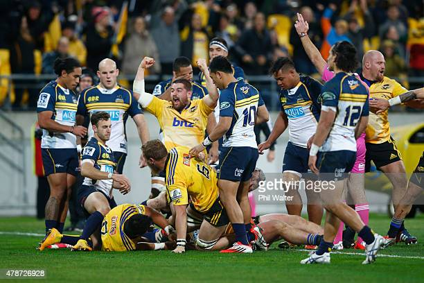 Dane Coles of the Hurricanes celebrates the try scored by Ardie Savea during the Super Rugby Semi Final match between the Hurricanes and the Brumbies...