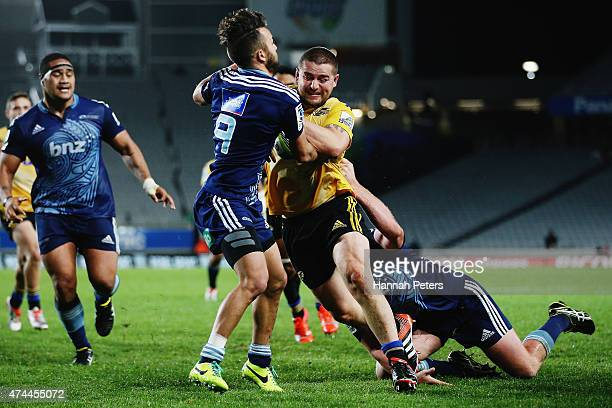 Dane Coles of the Hurricanes charges over to score a try during the round 15 Super Rugby match between the Blues and the Hurricanes at Eden Park on...