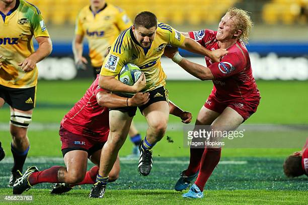 Dane Coles of the Hurricanes fends Beau Robinson of the Reds during the round 11 Super Rugby match between the Hurricanes and the Reds at Westpac...