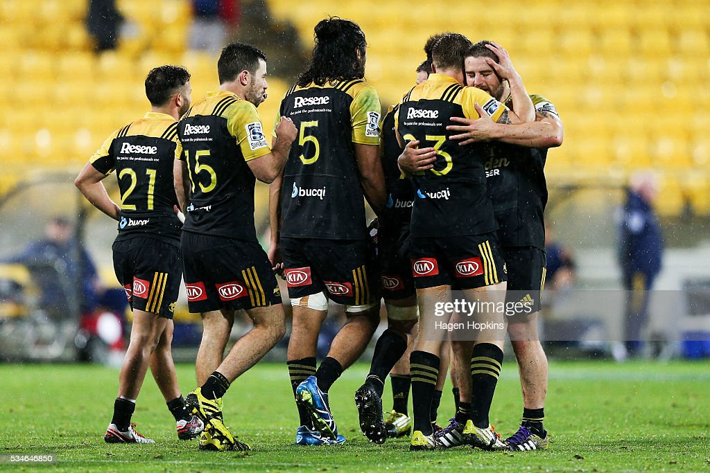 Dane Coles of the Hurricanes hugs teammate Jason Woodward after winning the round 14 Super Rugby match between the Hurricanes and the Highlanders at Westpac Stadium on May 27, 2016 in Wellington, New Zealand.