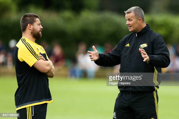 Dane Coles of the Hurricanes speaks to Technical Coach Richard Watt of the Hurricanes on during the Super Rugby preseason match between the...