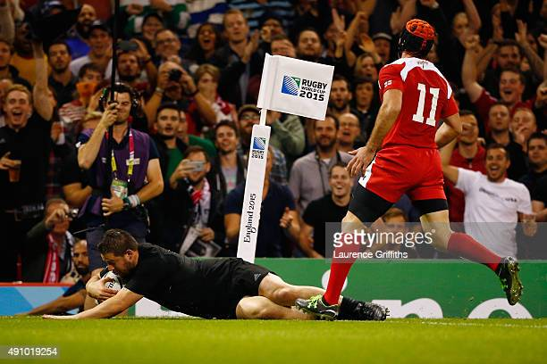 Dane Coles of the New Zealand All Blacks goes over to score their fourth try during the 2015 Rugby World Cup Pool C match between New Zealand and...