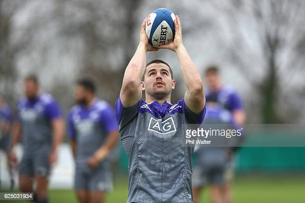 Dane Coles of the New Zealand All Blacks throws the ball into the lineout during training at the Suresnes Rugby Club on November 22 2016 in Paris...