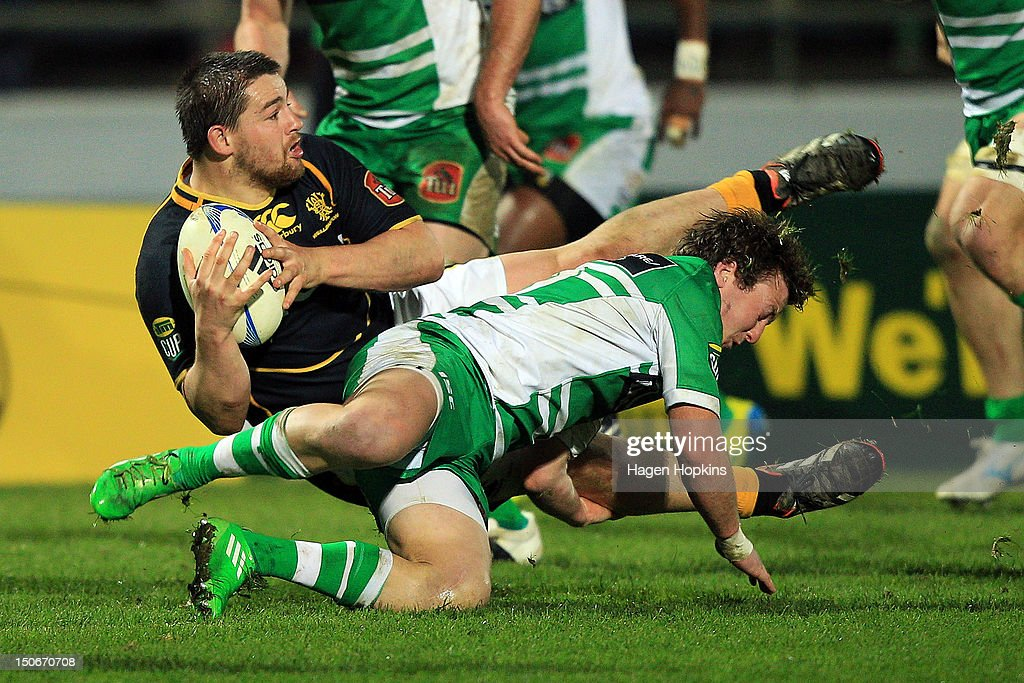 Dane Coles of Wellington is tackled by Karl Bryson of Manawatu during the round one ITM Cup match between Manawatu and Wellington at FMG Stadium on August 24, 2012 in Palmerston North, New Zealand.