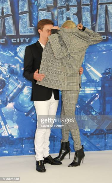 Dane DeHaan and Cara Delevingne attend a photocall for 'Valerian And The City Of A Thousand Planets' at The Langham Hotel on July 24 2017 in London...
