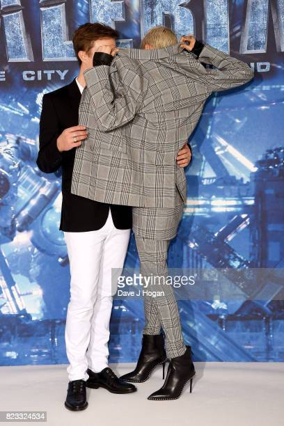 Dane DeHaan and Cara Delevingne attend the photocall of 'Valerian and The City of a Thousand Planets' at The Langham Hotel on July 24 2017 in London...