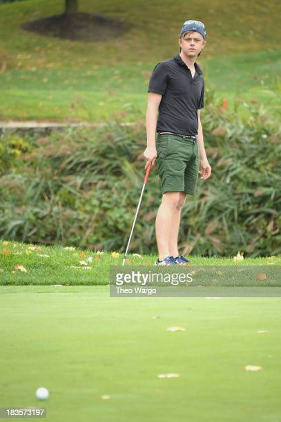 Dane DeHaan plays a round of golf at the Screen Actors Guild Foundation Inaugural New York Golf Classic at Trump National Golf Club Westchester on...