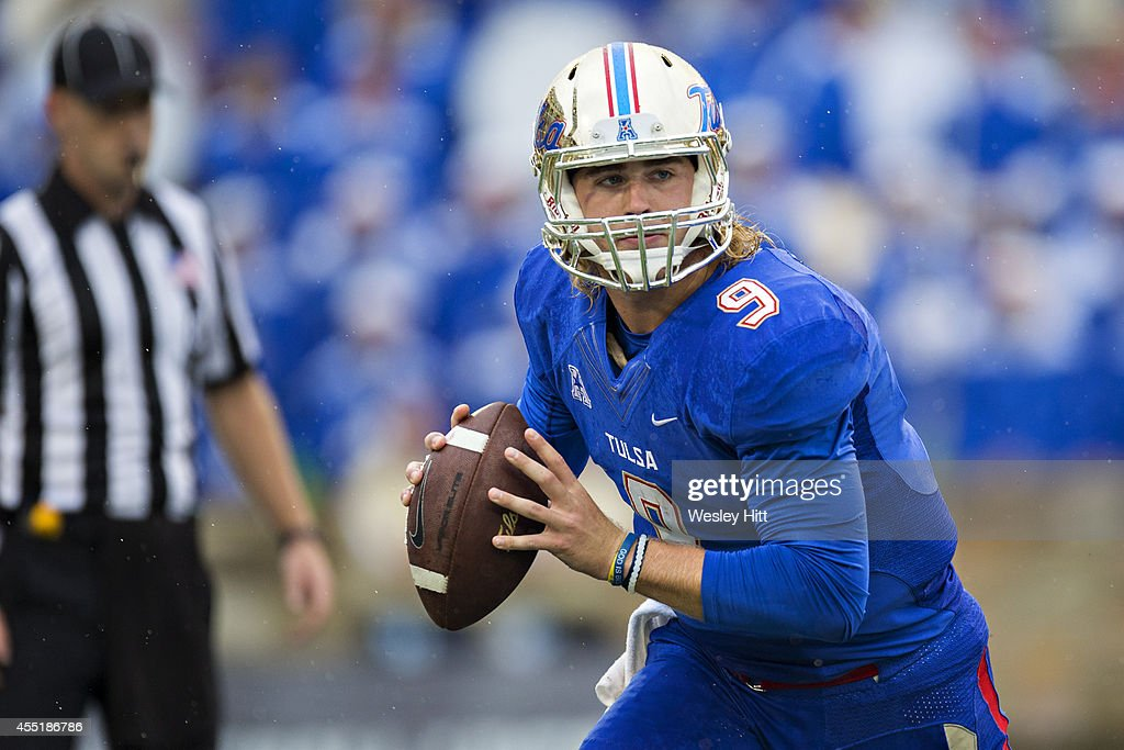 Dane Evans of the Tulsa Golden Hurricanes rolls out to pass against the Oklahoma Sooners at HA Chapman Stadium on September 6 2014 in Tulsa Oklahoma...