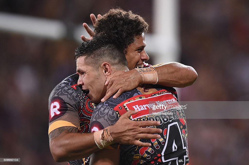 Dane Gagai of the Indigenous All Stars celebrates scoring a try with James Roberts during the NRL match between the Indigenous All-Stars and the World All-Stars at Suncorp Stadium on February 13, 2016 in Brisbane, Australia.