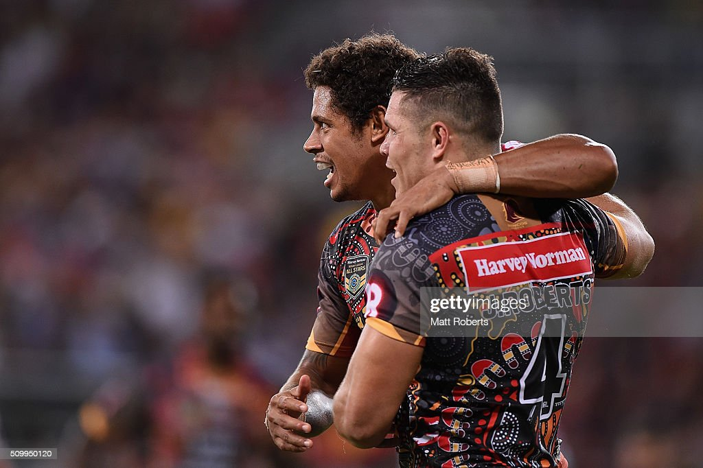 Dane Gagai of the Indigenous All Stars celebrates scoring a try with <a gi-track='captionPersonalityLinkClicked' href=/galleries/search?phrase=James+Roberts+-+Rugby+League+Player&family=editorial&specificpeople=15368710 ng-click='$event.stopPropagation()'>James Roberts</a> during the NRL match between the Indigenous All-Stars and the World All-Stars at Suncorp Stadium on February 13, 2016 in Brisbane, Australia.