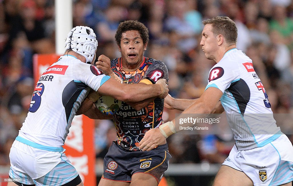 Dane Gagai of the Indigenous All Stars takes on the defence during the NRL match between the Indigenous All-Stars and the World All-Stars at Suncorp Stadium on February 13, 2016 in Brisbane, Australia.