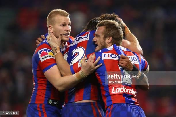 Dane Gagai of the Knights celebrates a try with team mates during the round 19 NRL match between the Newcastle Knights and the Brisbane Broncos at...