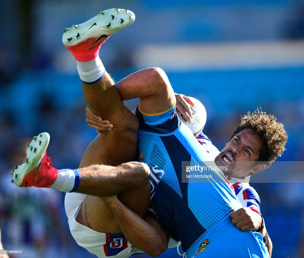 Dane Gagai of the Knights is tackled by Jarryd Hayne of the Titans during the round nine NRL match between the Gold Coast Titans and the Newcastle Knights at Cbus Super Stadium on April 29, 2017 in Gold Coast, Australia.
