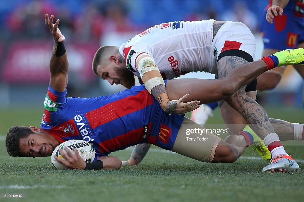 Dane Gagai of the Knights is tackled by Josh Dugan of the Dragons during the round 16 NRL match between the Newcastle Knights and the St George Illawarra Dragons at Hunter Stadium on June 25, 2016 in Newcastle, Australia.