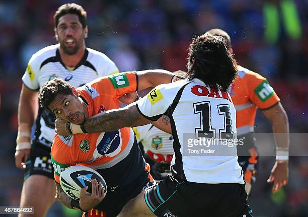 Dane Gagai of the Knights is tackled by the Panthers defence during the round four NRL match between the Newcastle Knights and the Penrith Panthers...