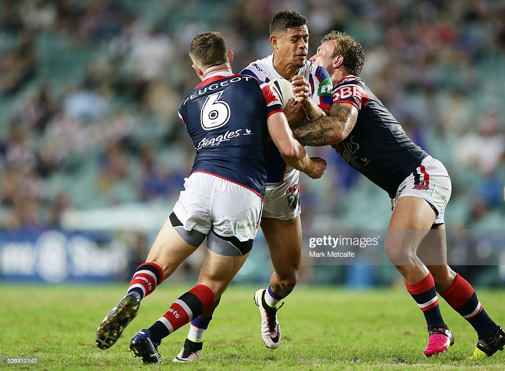 Dane Gagai of the Knights is tackled during the round nine NRL match between the Sydney Roosters and the Newcastle Knights at Allianz Stadium on April 30, 2016 in Sydney, Australia.