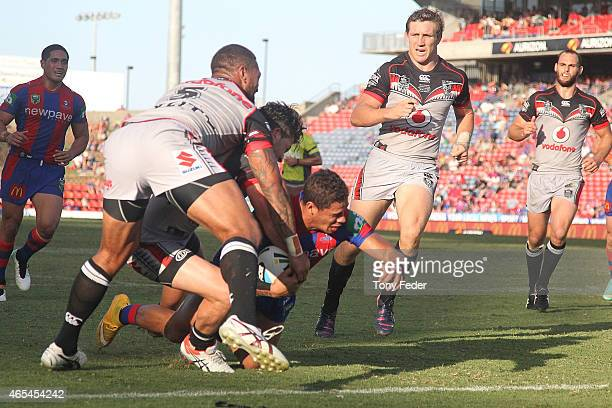 Dane Gagai of the Knights scores a try during the round one NRL match between the Newcastle Knights and the New Zealand Warriors at Hunter Stadium on...