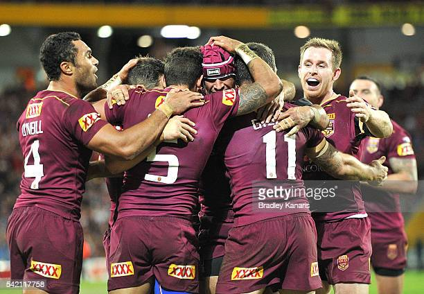 Dane Gagai of the Maroons and team mates celebrate a try during game two of the State Of Origin series between the Queensland Maroons and the New...