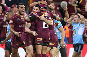 Dane Gagai of the Maroons celebrates a try with team mates during game two of the State Of Origin series between the Queensland Maroons and the New...