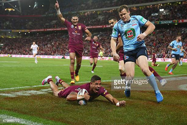 Dane Gagai of the Maroons celebrates scoring a try during game three of the State of Origin series between the Queensland Maroons and the New South...