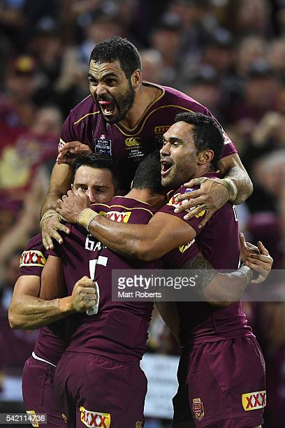 Dane Gagai of the Maroons celebrates scoring a try with Cooper Cronk Greg Inglis and Justin O'Neill of the Maroons during game two of the State Of...